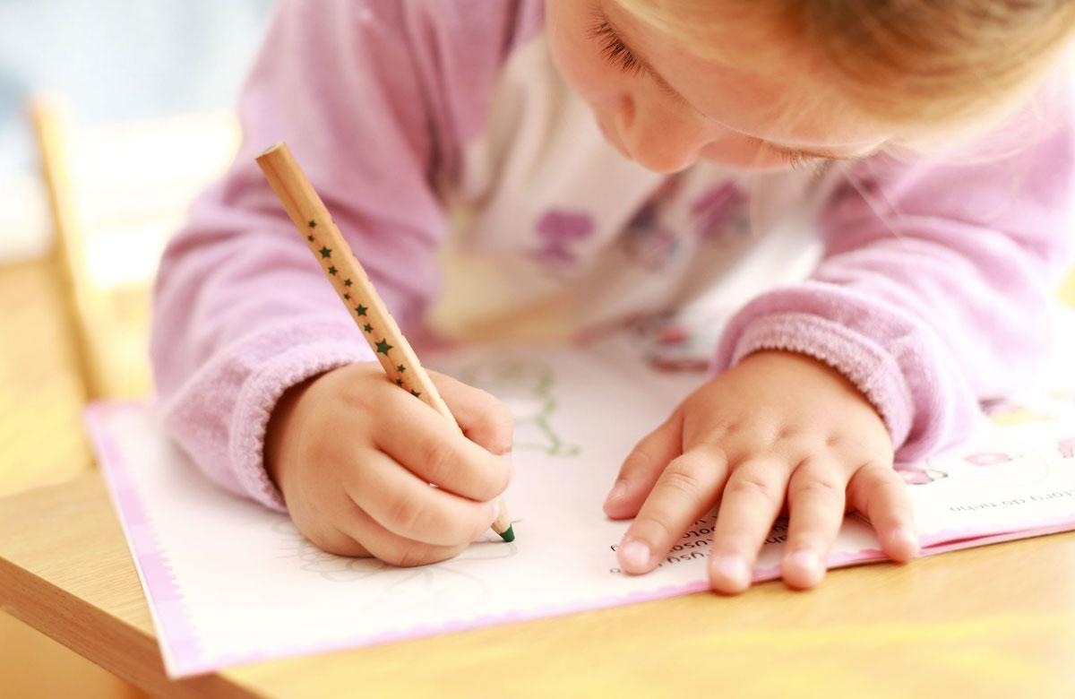 little girl colouring